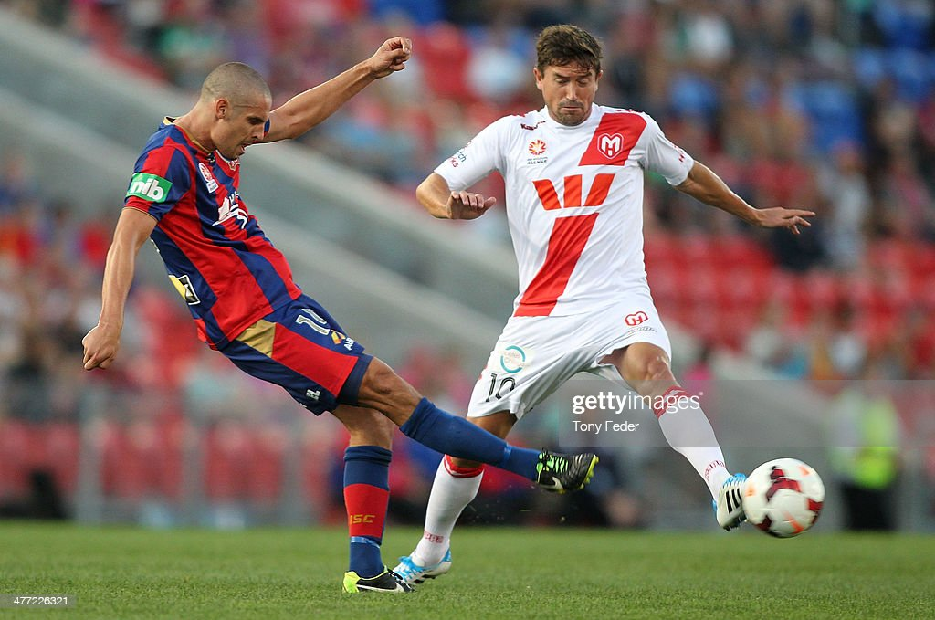 Harry Kewell of the Heart and Josh Mitchell of the Jets contest the ball during the round 22 A-League match between the Newcastle Jets and Melbourne Heart at Hunter Stadium on March 8, 2014 in Newcastle, Australia.