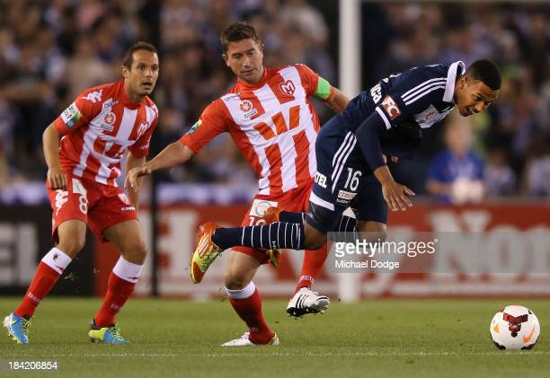Harry Kewell of the Heart and Rashid Mahazi of the Victory contest for the ball during the round one ALeague match between the Melbourne Victory and...