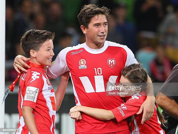 Harry Kewell of the Heart is hugged by his children after playing his final match and retiring from football during the round 27 ALeague match...