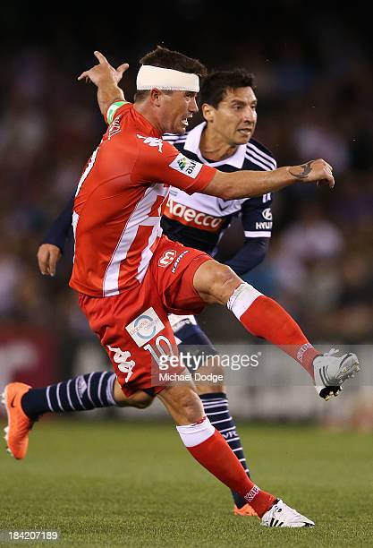 Harry Kewell of the Heart kicks the ball at goal during the round one ALeague match between the Melbourne Victory and the Melbourne Heart at Etihad...