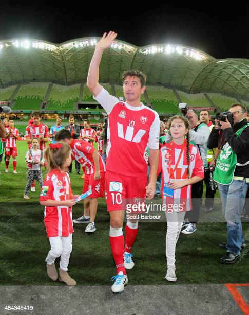 Harry Kewell of the Heart walks down the players tunnel with his children after playing his final match and retiring from football during the round...