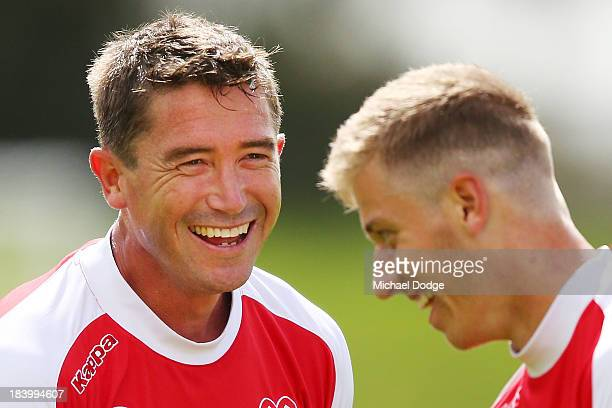 Harry Kewell reacts with Stefan Mauk during a Melbourne Heart ALeague training session at Epping Stadium on October 11 2013 in Melbourne Australia