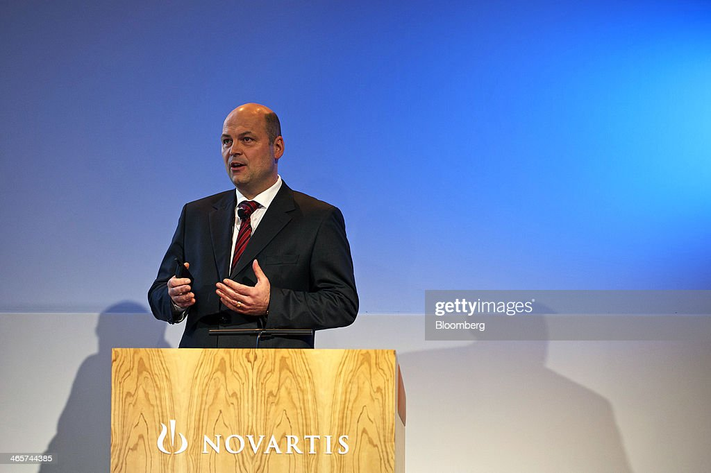 Harry Kirsch, chief financial officer of Novartis AG, gestures as he speaks during a news conference to announce the company's results in Basel, Switzerland, on Wednesday, Jan. 29, 2014. Novartis AG, Europe's biggest drugmaker by sales, said fourth-quarter profit fell as currencies in emerging markets weakened against the dollar. Photographer: Gianluca Colla/Bloomberg via Getty Images