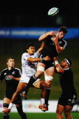 Harry Luteru of Samoa competes with Geoffrey Cridge of New Zealand for the ball during the 2014 Junior World Championships match between New Zealand...