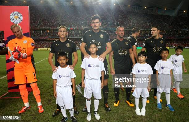KONG JULY Harry Maguire Marc Albrighton and Danny Drinkwater of Leicester City ahead of the Premier League Asia Trophy Final between Liverpool FC and...