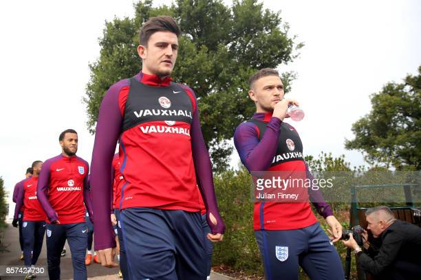 Harry Maguire of England and Kieran Trippier of England walk out prior to a England Training Session at the Tottenham Hotspur training ground on...