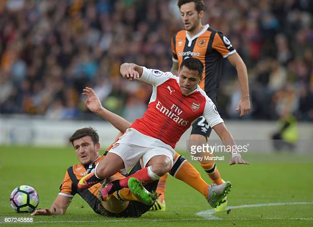 Harry Maguire of Hull City and Alexis Sanchez of Arsenal battle for possession during the Premier League match between Hull City and Arsenal at KCOM...