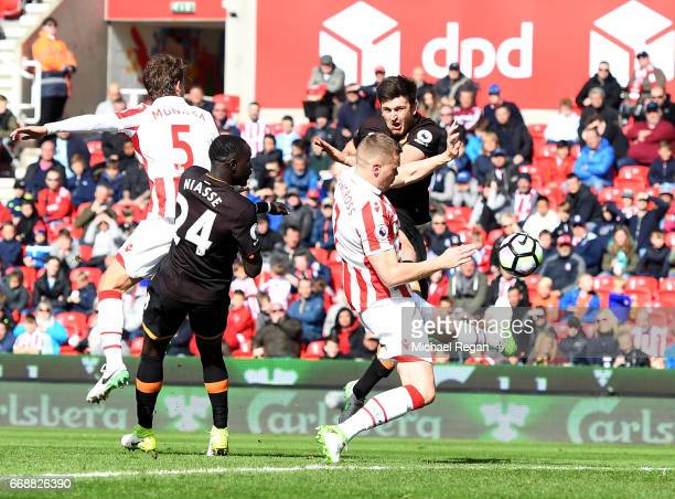 Harry Maguire of Hull City scores his sides first goal during the Premier League match between Stoke City and Hull City at Bet365 Stadium on April 15...
