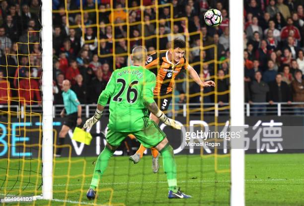 Harry Maguire of Hull City scores his sides fourth goal past Victor Valdes of Middlesbrough during the Premier League match between Hull City and...