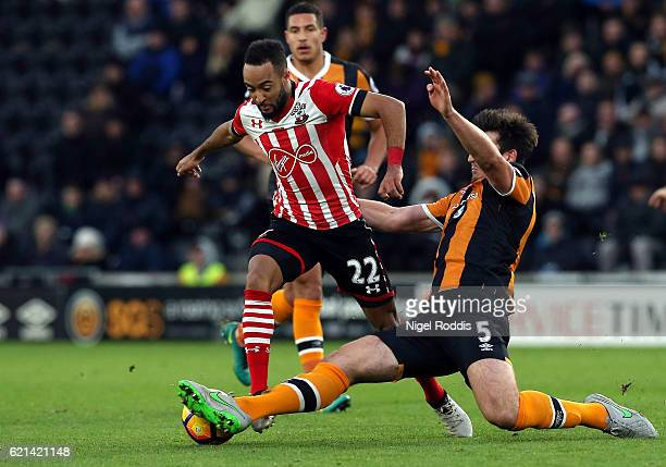 Harry Maguire of Hull City tackles Nathan Redmond of Southampton during the Premier League match between Hull City and Southampton at KC Stadium on...