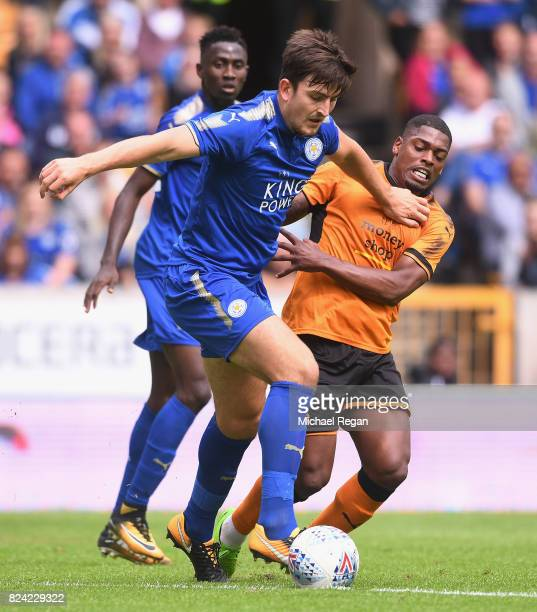 Harry Maguire of Leicester battles Ivan Cavalerio of Wolves during the preseason friendly match between Wolverhampton Wanderers and Leicester City at...