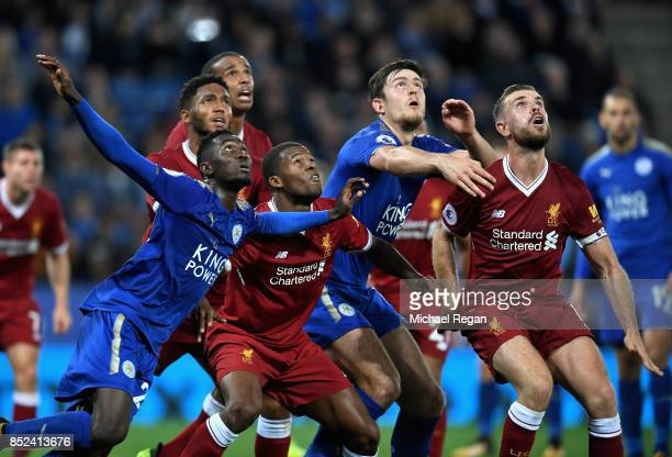 Harry Maguire of Leicester City and Jordan Henderson of Lierpool battle for possession in the air during the Premier League match between Leicester...