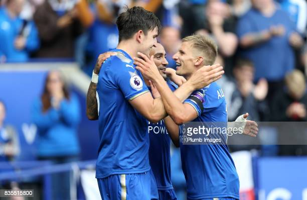 Harry Maguire of Leicester City celebrates with Danny Simpson and Marc Albrighton of Leicester City after scoring to make it 20 during the Premier...