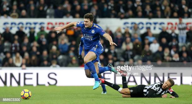 Harry Maguire of Leicester City gets away from Dwight Gayle of Newcastle United during the Premier League match between Newcastle United and...