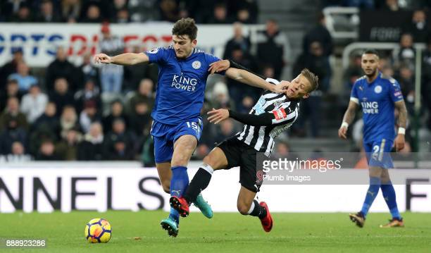 Harry Maguire of Leicester City holds off Dwight Gayle of Newcastle United during the Premier League match between Newcastle United and Leicester...