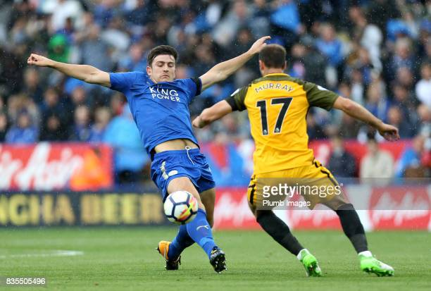 Harry Maguire of Leicester City in action with Glenn Murray of Brighton and Hove Albion during the Premier League match between Leicester City and...