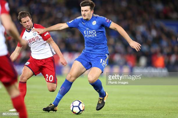 Harry Maguire of Leicester City in action with Grzegorz Krychowiak of West Bromwich Albion during the Premier League match between Leicester City and...
