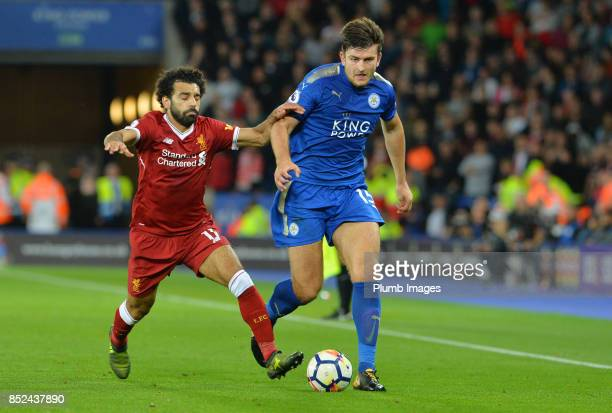 Harry Maguire of Leicester City in action with Mohamed Salah of Liverpool during Premier League match between Leicester City and Liverpool at The...