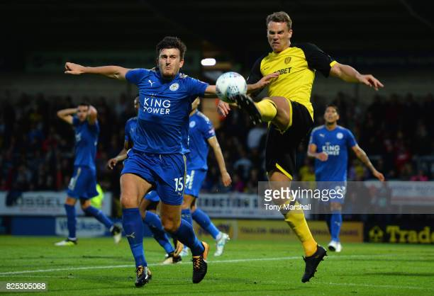 Harry Maguire of Leicester City tackles Ben Turner of Burton Albion during the PreSeason Friendly match between Burton Albion v Leicester City at...