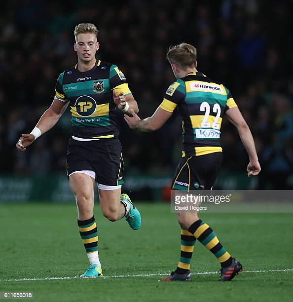Harry Mallinder is congratulated by team mate Sam Olver after scoring the match winning penalty during the Aviva Premiership match between...