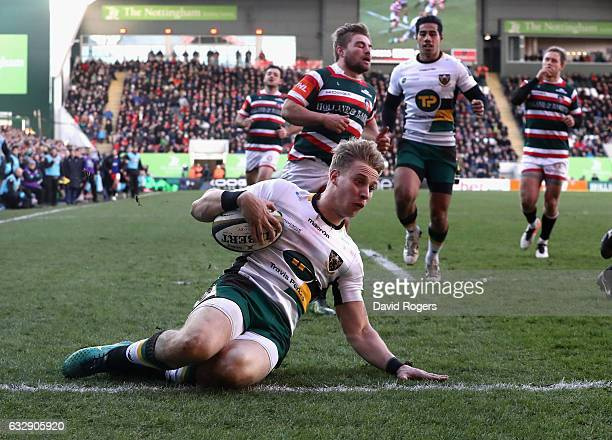Harry Mallinder of Northampton dives over for a try during the AngloWelsh Cup match between Leicester Tigers and Northampton Saints at Welford Road...