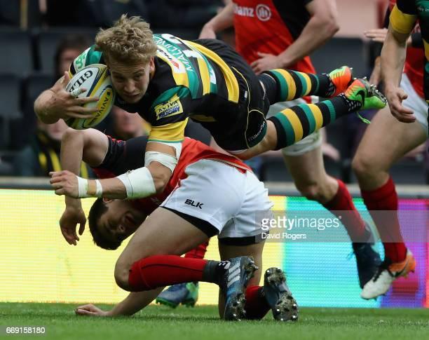 Harry Mallinder of Northampton is tackled by Alex Lozowski during the Aviva Premiership match between Northampton Saints and Saracens at Stadium mk...