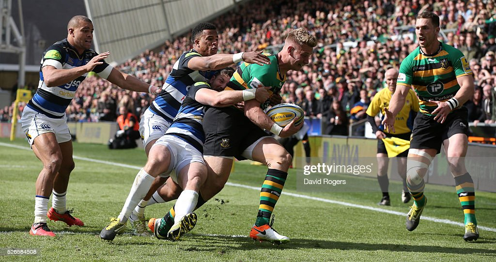 Harry Mallinder of Northampton is tackled by Jeff Williams and Anthony Watson during the Aviva Premiership match between Northampton Saints and Bath at Franklin's Gardens on April 30, 2016 in Northampton, England.