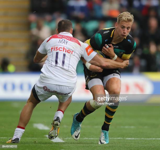 Harry Mallinder of Northampton is tackled by Jonny May during the Aviva Premiership match between Northampton Saints and Leicester Tigers at...