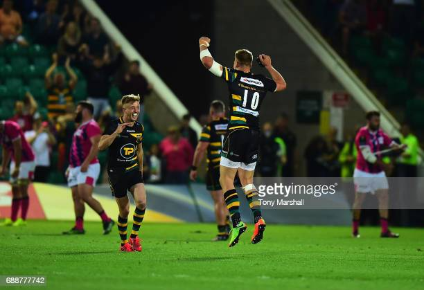 Harry Mallinder of Northampton Saints celebrates with Sam Olver of Northampton Saints their win at the end of the Champions Cup Playoff Final between...