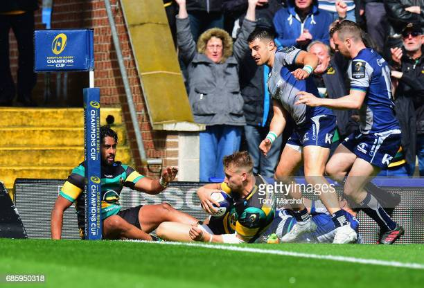 Harry Mallinder of Northampton Saints slides in to score their first try during Champions Cup Playoff match between Northampton Saints and Connacht...