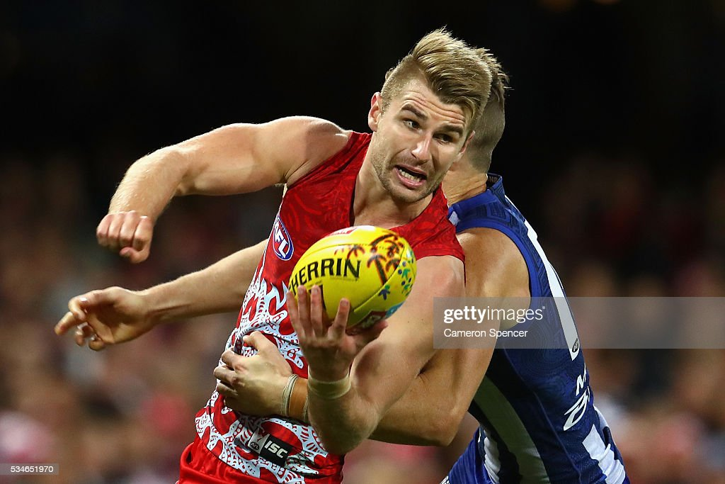 Harry Marsh of the Swans handpasses during the round 10 AFL match between the Sydney Swans and the North Melbourne Kangaroos at Sydney Cricket Ground on May 27, 2016 in Sydney, Australia.