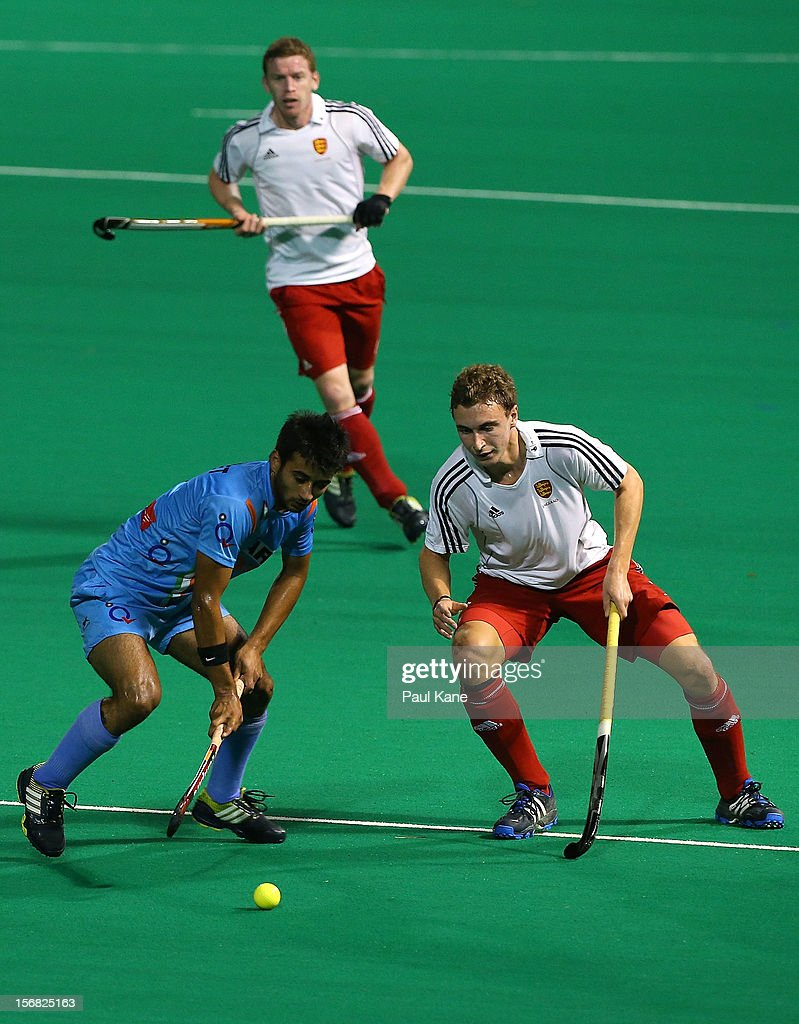 Harry Martin of England and Manpreet Singh of India contest for the ball in the England v India game during day one of the 2012 International Super Series at Perth Hockey Stadium on November 22, 2012 in Perth, Australia.
