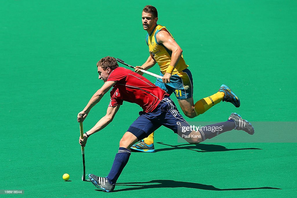 Harry Martin of England passes the ball in the gold medal match between the Australian Kookaburras and England during day four of the 2012 International Super Series at Perth Hockey Stadium on November 25, 2012 in Perth, Australia.