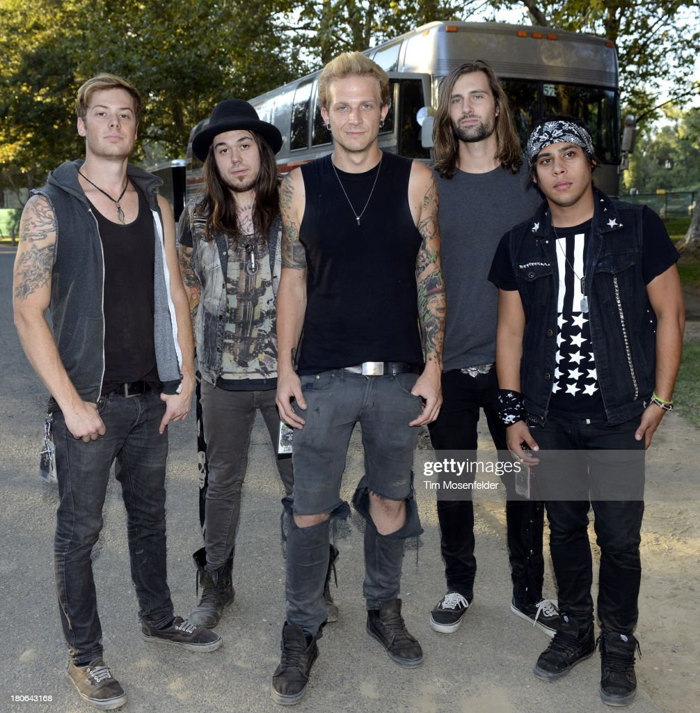 Harry McDonald, Nicholas Wiggins, Austin Held, Nick McMahan, and Josh Mouser of Girl on Fire pose at the Aftershock Music Festival at Discovery Park on September 14, 2013 in Sacramento, California.
