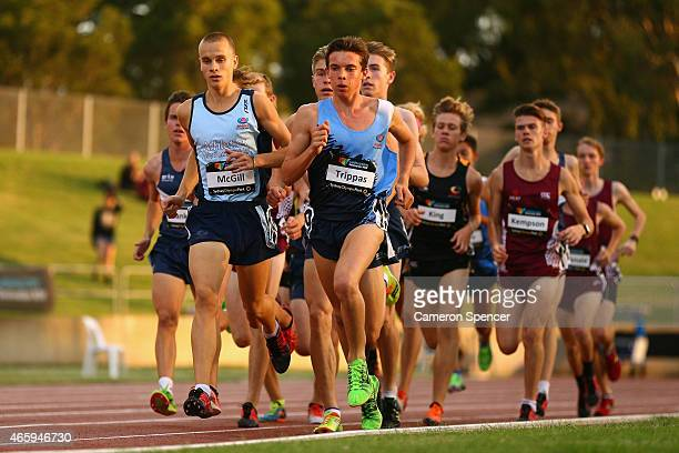 Harry McGill of New South Wales and Edward Trippas of New South Wales compete in the mens U18 3000m during the Australian Junior Athletics...