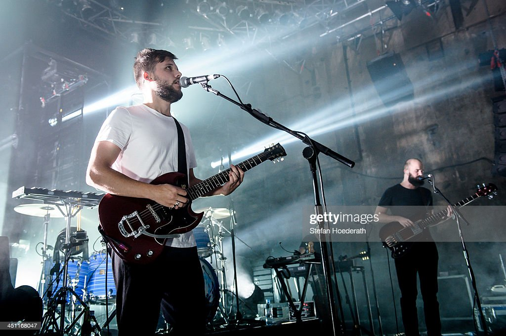 Harry McVeigh and Charles Cave of White Lies perform live during a concert at Kesselhaus on November 21 2013 in Berlin Germany