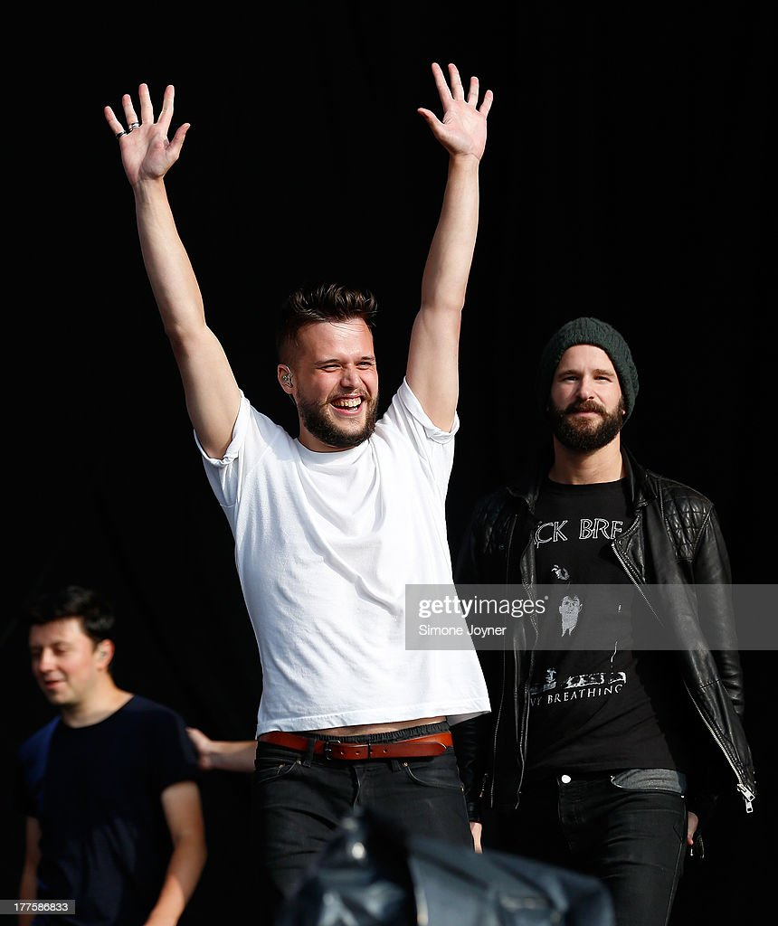 Harry McVeigh and Charles Cave of White Lies perform live on the main stage during day two of Reading Festival at Richfield Avenue on August 24 2013...