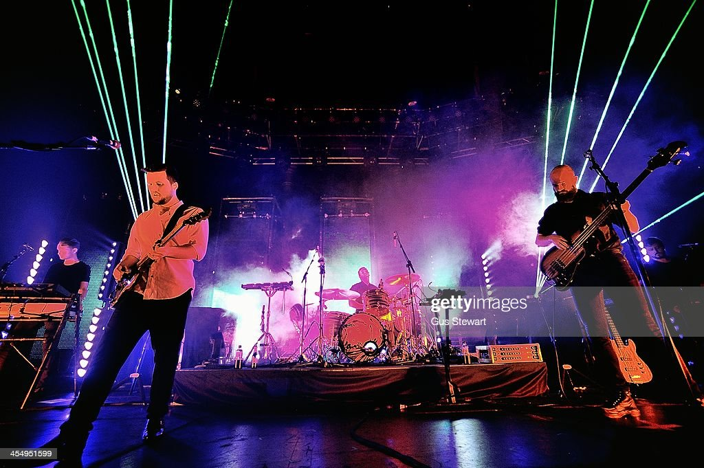 Harry McVeigh Jack Brown and Charles Cave of White Lies perform on stage at The Roundhouse on December 10 2013 in London United Kingdom