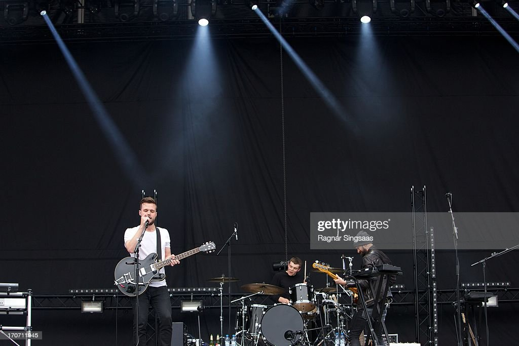 Harry McVeigh Jack LawrenceBrown and Charles Cave of White Lies perform on stage on Day 3 of Provinssirock 2013 on June 16 2013 in Seinajoki Finland