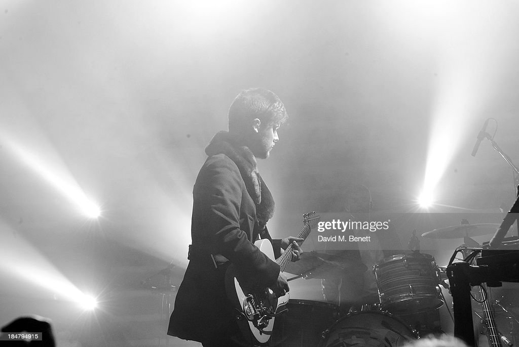 Harry McVeigh of White Lies performs at the Burberry Brit Rhythm gig in London at Village Underground on October 16, 2013 in London, England.
