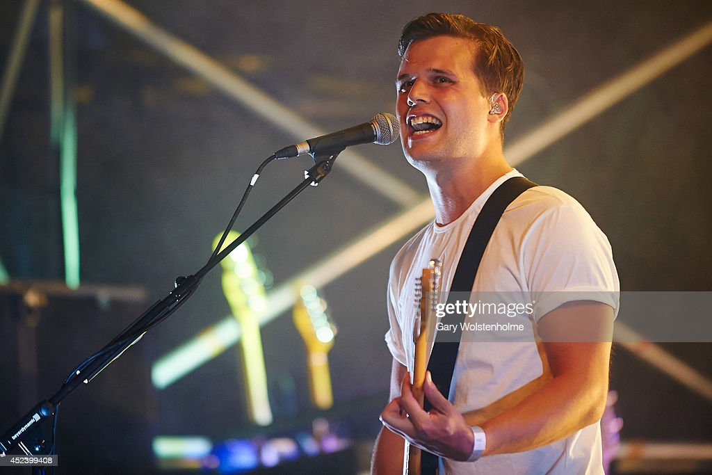 Harry McVeigh of White Lies performs on stage at Truck Festival at Hill Farm on July 19, 2014 in Steventon, United Kingdom.