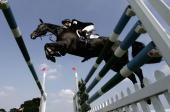 Harry Meade and Midnight Dazzler in action in the Show Jumping during the 2005 Burghley Horse Trials on September 4 2005 in Stamford Lincolnshire...