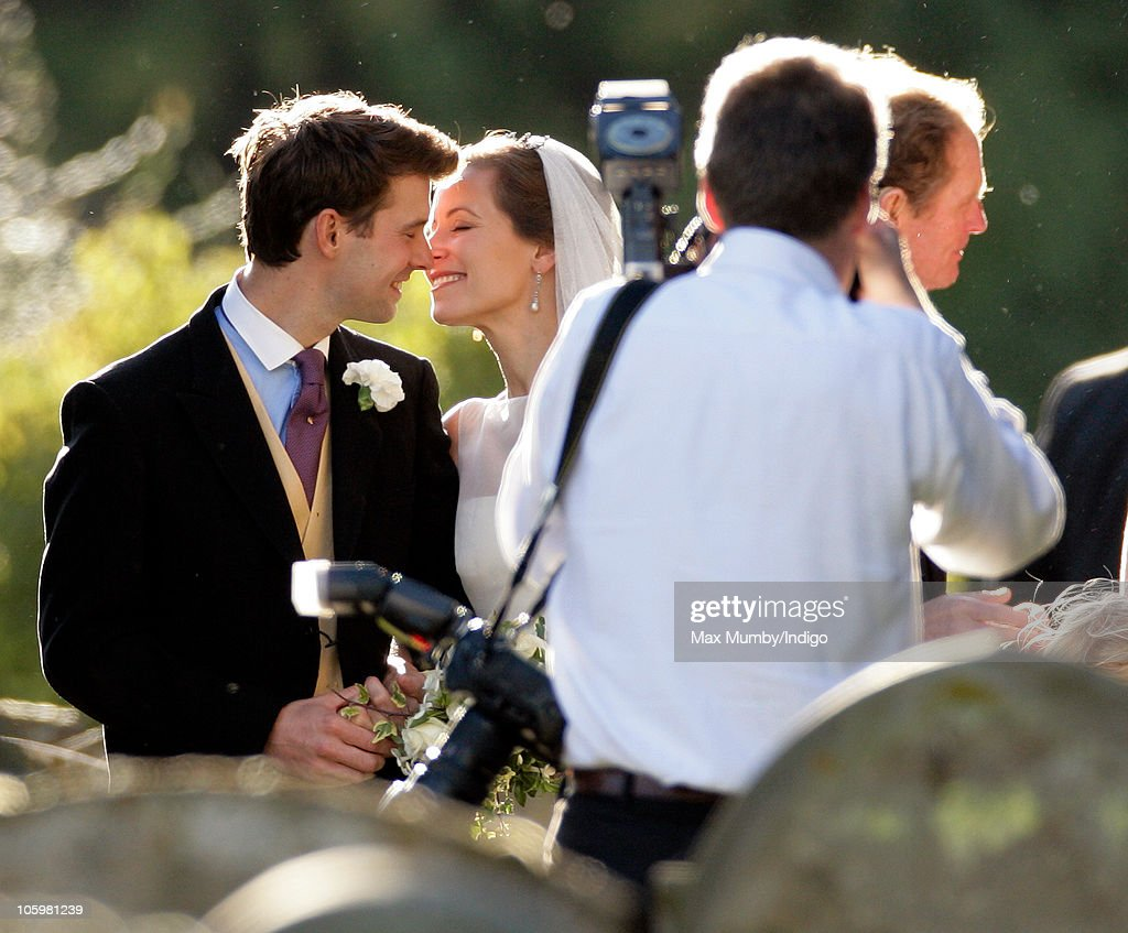 Harry Meade and Rosie Bradford kiss as they leave the Church of St. Peter and St. Paul on October 23, 2010 in Northleach near Cheltenham, England.