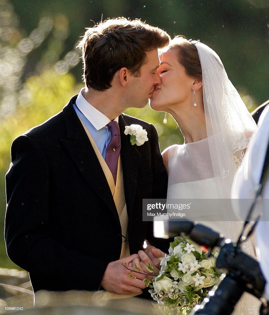 Harry Meade and Rosie Bradford kiss as they leave the Church of St Peter and St Paul on October 23 2010 in Northleach near Cheltenham England