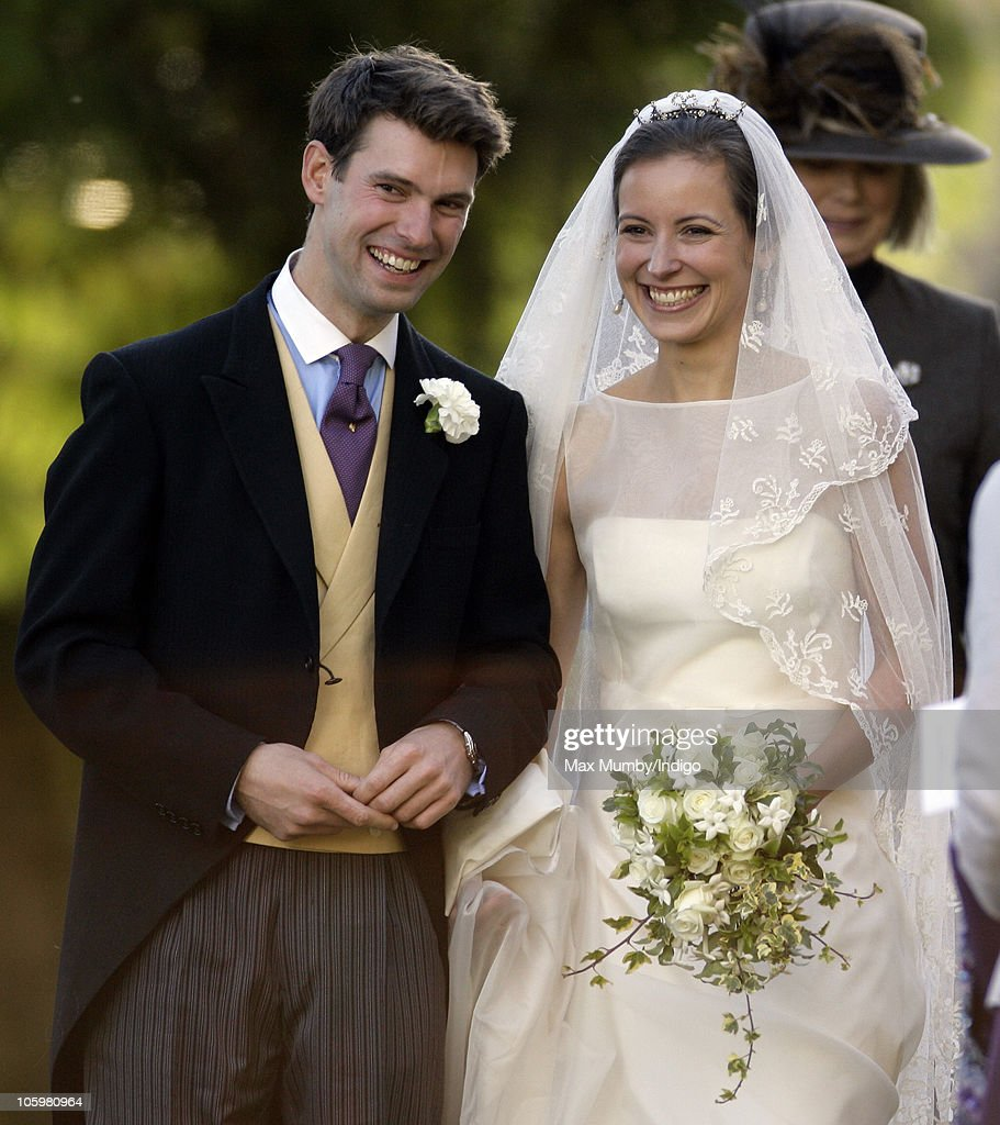 Harry Meade and Rosie Bradford leave the Church of St Peter and St Paul Northleach after their wedding on October 23 2010 in Cheltenham England