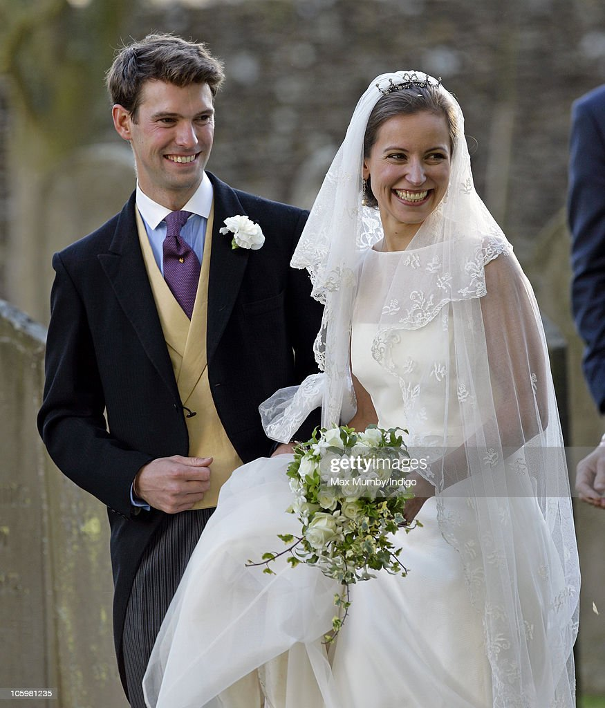 Harry Meade and Rosie Bradford leave the Church of St. Peter and St. Paul on October 23, 2010 in Northleach near Cheltenham, England.