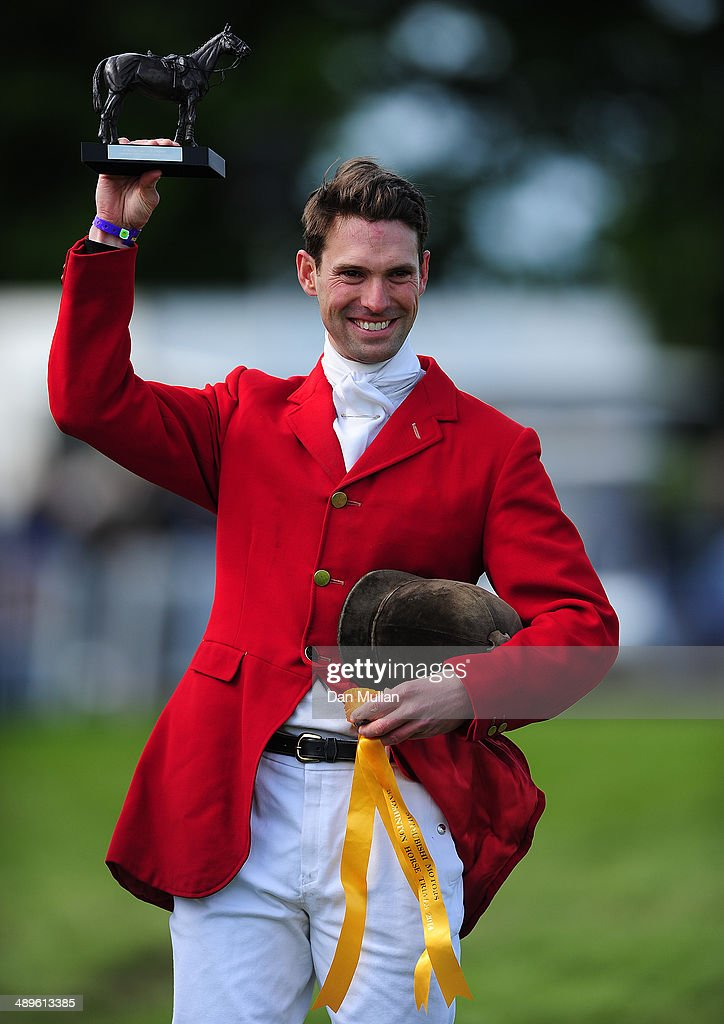 <a gi-track='captionPersonalityLinkClicked' href=/galleries/search?phrase=Harry+Meade&family=editorial&specificpeople=2264034 ng-click='$event.stopPropagation()'>Harry Meade</a> celebrates with the Cotswold Life Trophy on day five of the Badminton Horse Trials on May 11, 2014 in Badminton, England.