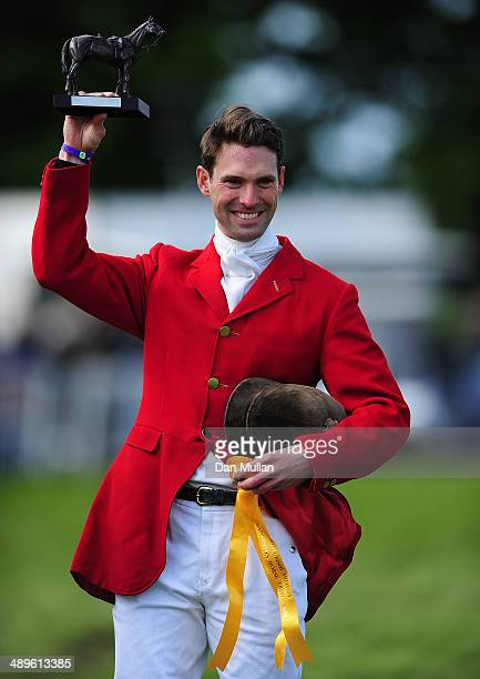 Harry Meade celebrates with the Cotswold Life Trophy on day five of the Badminton Horse Trials on May 11 2014 in Badminton England