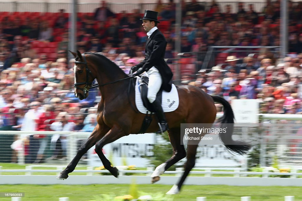 <a gi-track='captionPersonalityLinkClicked' href=/galleries/search?phrase=Harry+Meade&family=editorial&specificpeople=2264034 ng-click='$event.stopPropagation()'>Harry Meade</a> of Great Britain rides Wild Lone during the dressage section of the Badminton Horse Trials on May 3, 2013 in Badminton, Gloucestershire.
