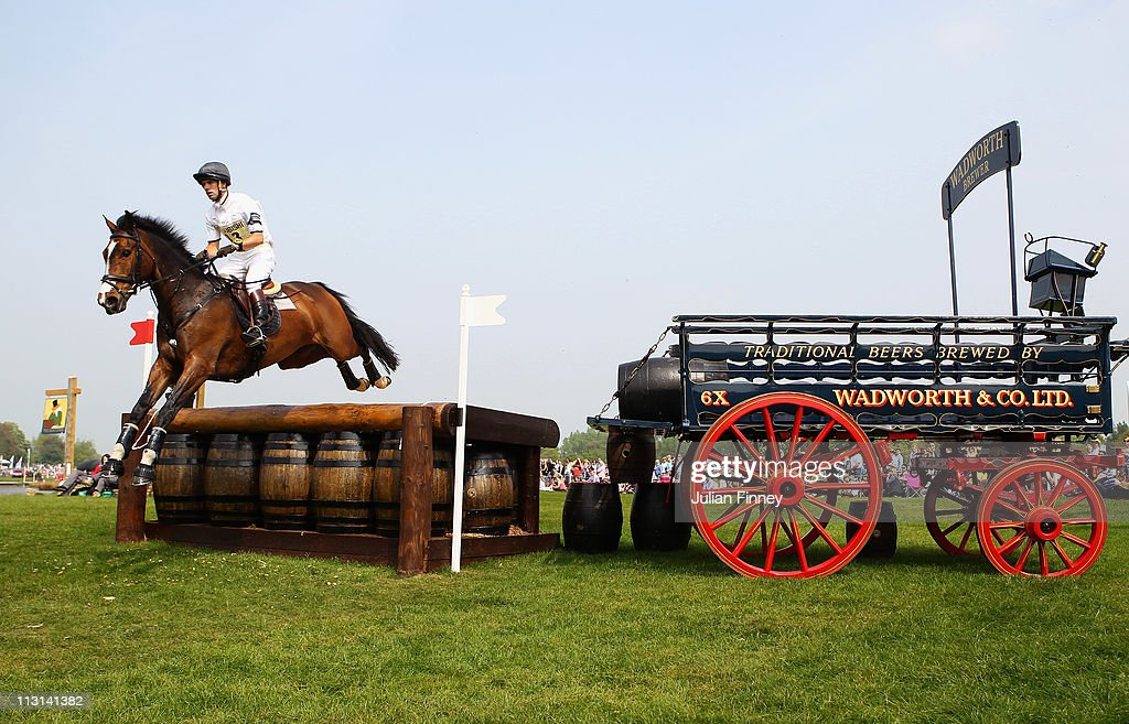 <a gi-track='captionPersonalityLinkClicked' href=/galleries/search?phrase=Harry+Meade&family=editorial&specificpeople=2264034 ng-click='$event.stopPropagation()'>Harry Meade</a> riding Wild Lone jumps over the Wadworth Barrels as they compete in the cross country stage during day three of the Badminton Horse Trials on April 24, 2011 in Badminton, Gloucestershire.